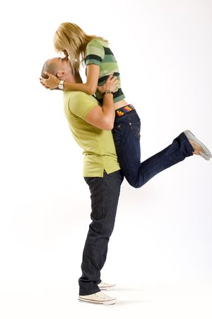 young man holding his girlfriend in the air Stock Photo - 4942531