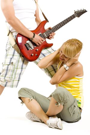 guitarist playing an annoying song to a girl photo
