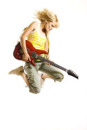 rocker: passionate woman guitarist jumps in the air