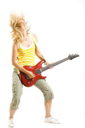 headbanging woman guitarist playing her guitar Stock Photo - 4942324