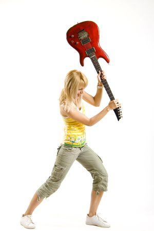 woman guitarist breaking her guitar Stock Photo - 4942426
