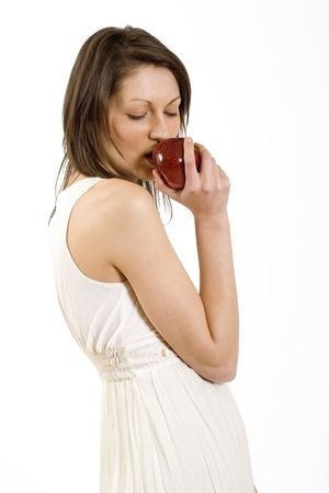 woman biting a red apple Stock Photo - 4942470