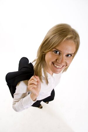 wide angle picture of an attractive businesswoman with coat on her back Stock Photo - 4942424