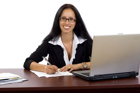attractive businesswoman at her desk signing papers photo