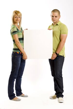 young couple presenting a blank board photo