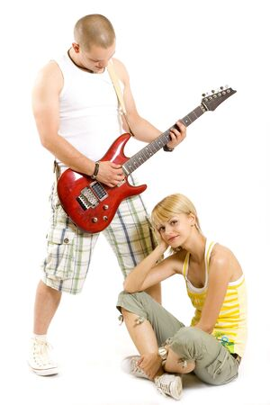man playing the guitar for his girlfriend photo