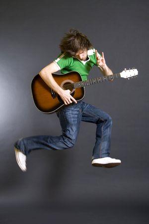 headbanging:  passionate guitarist jumps in the air