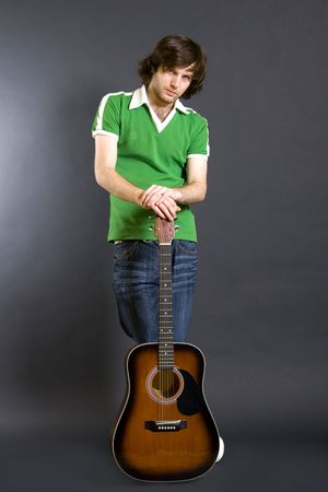 guitarist with an acoustic guitar photo