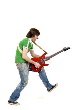 headbanging: passionate guitarist playing his electric guitar Stock Photo