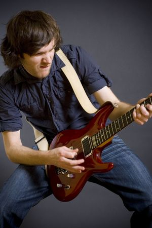 passionate guitarist playing his electric guitar photo