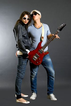 bass guitar women: young couple playing together an electric guitar Stock Photo