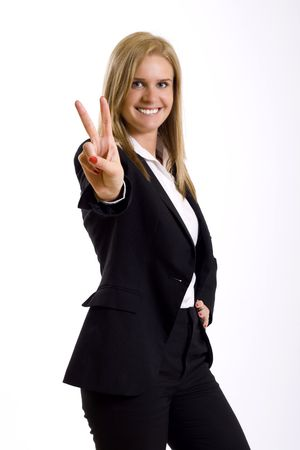 attractive businesswoman making her victory sign photo