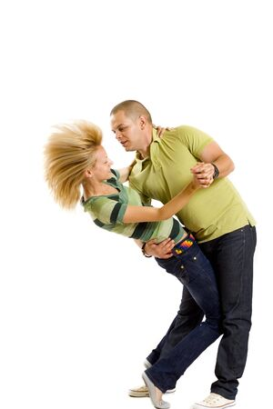 casual young couple dancing over white background Stock Photo - 5446803