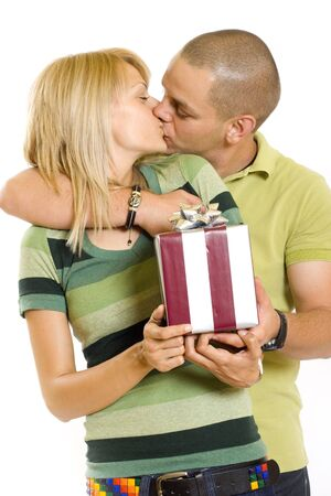 man giving a present tot his girlfriend and kissing her photo