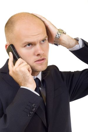 young businessman with bad news on his cell phone Stock Photo - 5511185