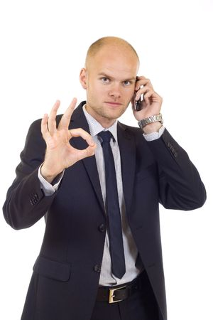 officetower: businessman on the phore aproving the good news Stock Photo