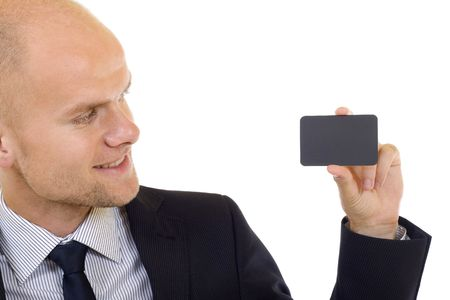 closeup picture of a business man handing a blank business card photo