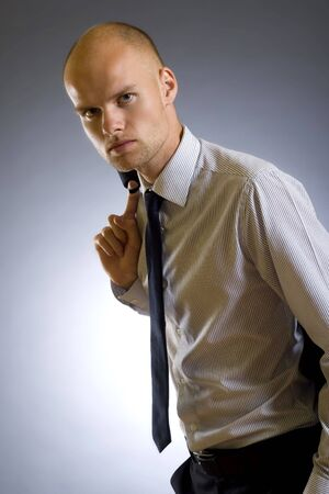 image of a handsome young businessman with coat on shoulder Stock Photo - 5511145