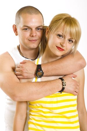 Young love couple smiling. Over white background Stock Photo - 5544598