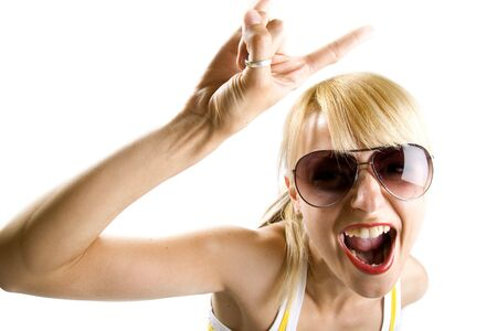 characteristic: Young woman with characteristic heavy metal hand gesture Stock Photo