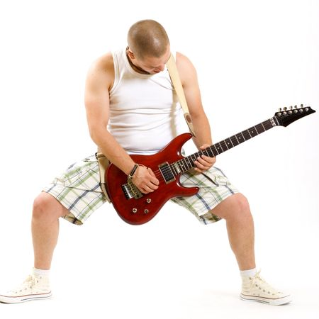 Portrait of young cool man playing electric guitar isolated photo