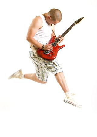 Passionate guitarist jumps isolated on white background Stock Photo - 5544578