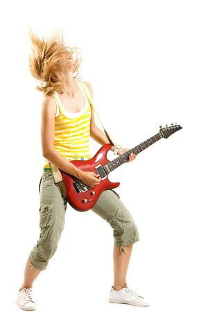 headbanging woman guitarist playing her guitar over white Stock Photo - 5544531