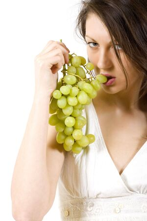 picture of a woman woman bitting from a grape Stock Photo - 5567775