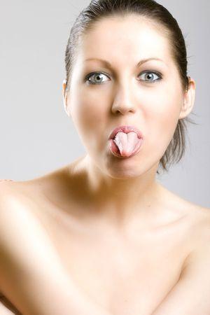 closeup of a womans face - tongue out photo