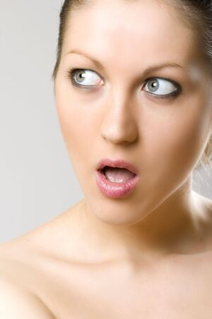 closeup of a womans face - shocked photo
