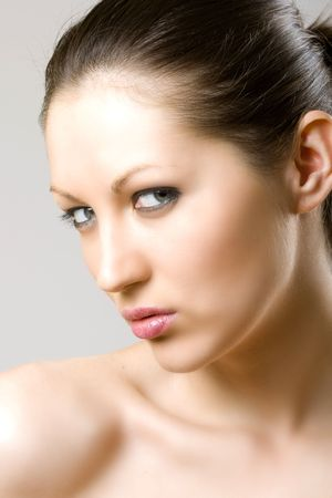 closeup of a woman's face - checking you out Stock Photo - 5544573