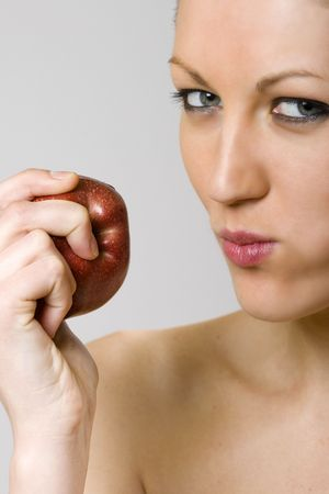 closeup of a woman eating a red apple photo