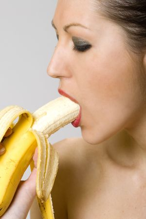 closeup picture of a young woman eating banana photo