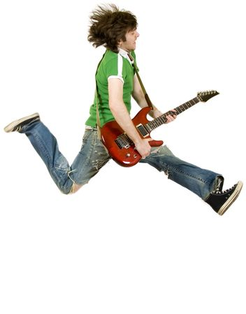 picture of a passionate guitarist who jumps in the air