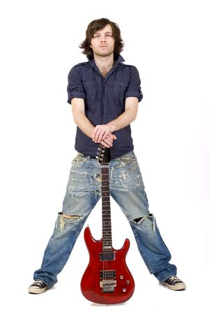 an electric guitar between the legs of a guitarist Stock Photo - 5544617