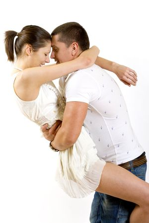 young man holding his girlfriend in the air over white Stock Photo - 5592373