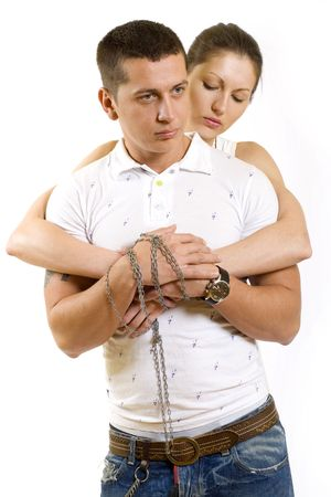 couple chained together and woman embracing her man from behind Stock Photo - 5592382
