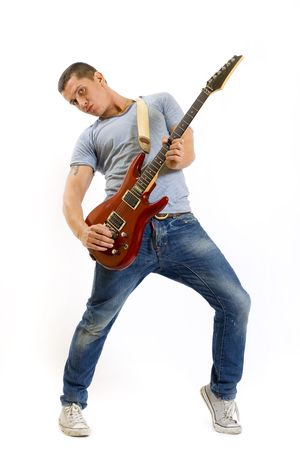headbanging: passionate guitarist playing his electric guitar over white background Stock Photo