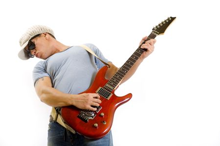 Portrait of young funky musician holding and playing an electric guitar photo