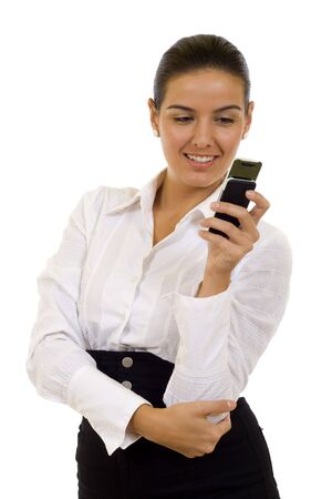 Image of pretty woman holding her mobile and sending sms Stock Photo - 5641258