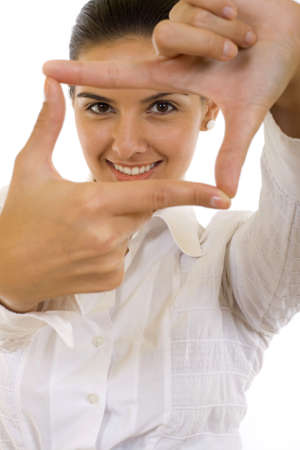 threw: A woman looking threw her fingers finding the angle Stock Photo