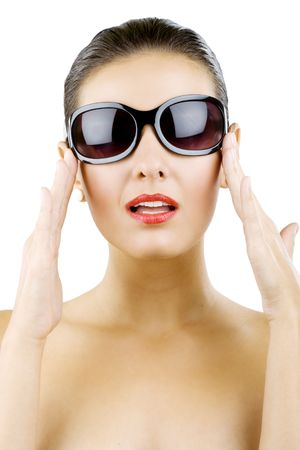 Sexy young woman holding her sunglasses over white Stock Photo - 5641263