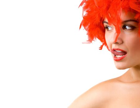 Gorgeous young girl in red feathers with tongue ring exposed Stock Photo - 5641348
