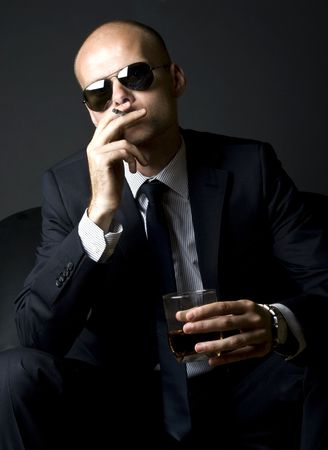young businessman smoking a cigarette and having a superior attitude photo