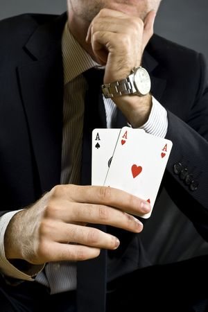closeup picture of a pair of aces held by a businessman Stock Photo - 5787798