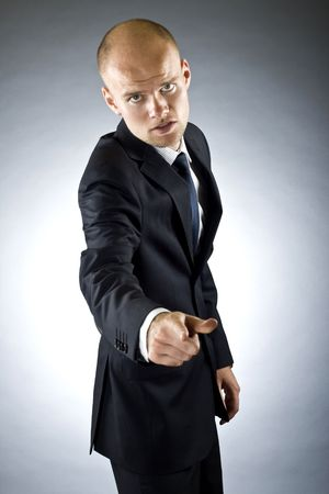 portrait of a young business man pointing at the camera on a dark background Stock Photo - 5787818