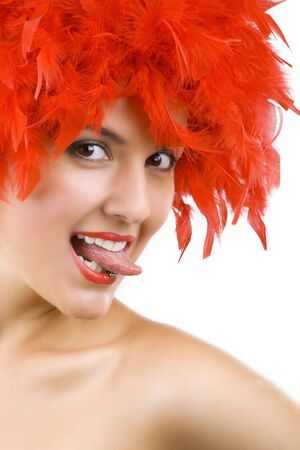 Gorgeous young girl in red feathers with tongue ring exposed photo