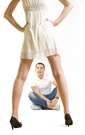 Young man sitting and watching attractive woman in dress Stock Photo - 5787779
