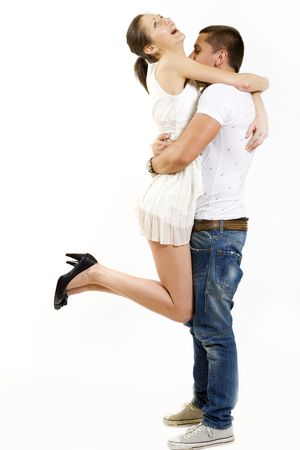 young man holding his girlfriend in the air over white Stock Photo - 5787762