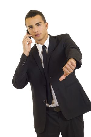 Businessman with bad news on his cell phone disapproving Stock Photo - 5837324